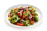 Salad with smoked ham on white background