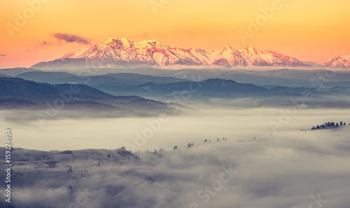 Papiers peints Beige Beautiful spring panorama over misty Spisz highland to snowy Tatra mountains in the morning, Poland