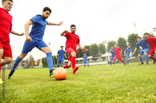 Playing a football match