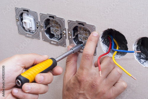 installation of electrical sockets Poster