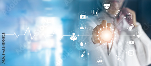 Medicine doctor and stethoscope in hand touching icon medical network connection   with modern virtual screen interface, medical technology network concept © ipopba