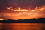 Beautiful red fire sunset on lake Baikal in summer evening