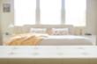 Beige leather empty bench in bedroom