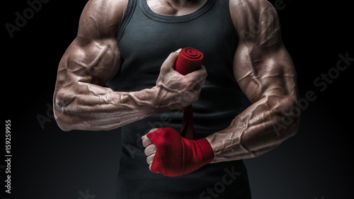 Close-up photo of strong man wrap hands