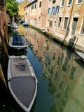 VENICE, ITALY - MAY 18, 2017 : canal of Venice with boats and bridge.