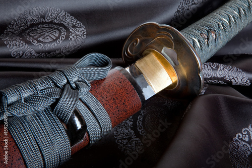 Japanese sword on silk Poster