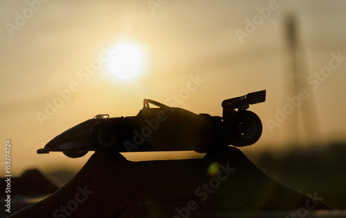 Fotobehang F1 Historic single-seater with sunset in background