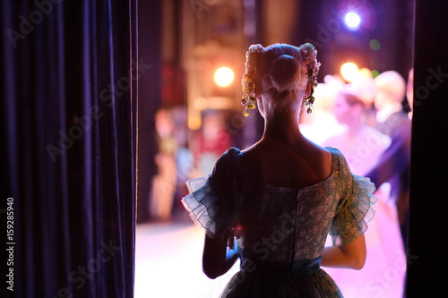A ballerina awaiting the moment of entering the stage in the play Poster