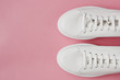 Overhead Shot Of White Sneakers On Pink Background