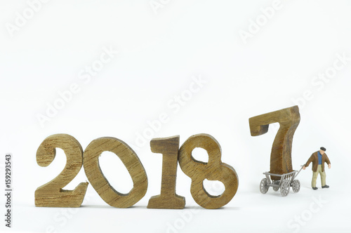 Poster Change to new year 2018, wooden number of 2018 and 2017 on cart with miniature w