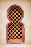 Wooden Arabian windows on orange plaster wall