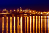 Havana bridge in Kiev at night with colorful illumination and reflection in Dnieper river