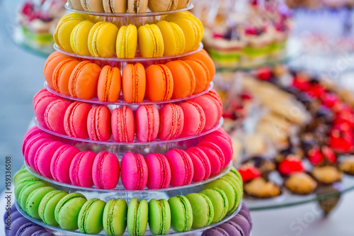 Fotobehang Macarons Delicious french macarons and cake dessert on plates