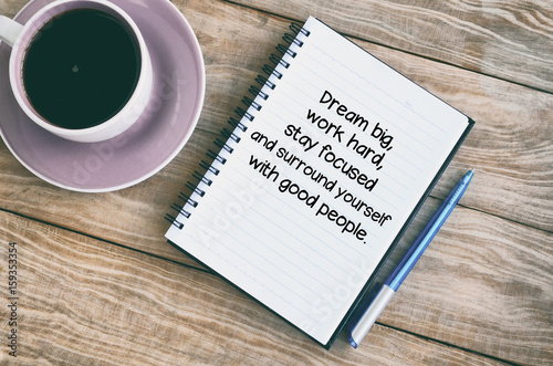 Inspirational quotes text on notepad - Dream big, work hard, stay focused and surround yourself with good people Photo by cn0ra