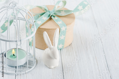 Poster Mint green lit candle in white lantern with gift