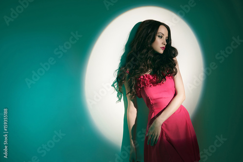 Beautiful brunette woman in beam of searchlight Poster