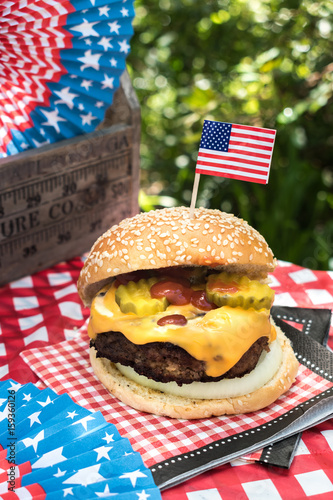 Poster Fourth of July celebration with All American hamburger