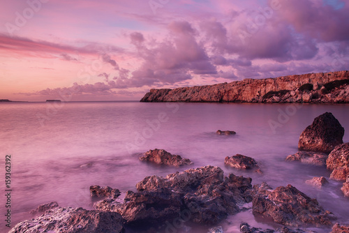 Aluminium Beautiful colorful sunrise at the sea with dramatic clouds and boulders. Beauty world natural outdoors travel background