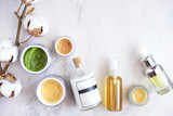 Natural skincare cosmetic products on white marble table from above. Creams, balms, masks, oils, serums.  Beauty blogger concept - 159380187