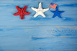 red white and blue starfish with American flag on rustic wood