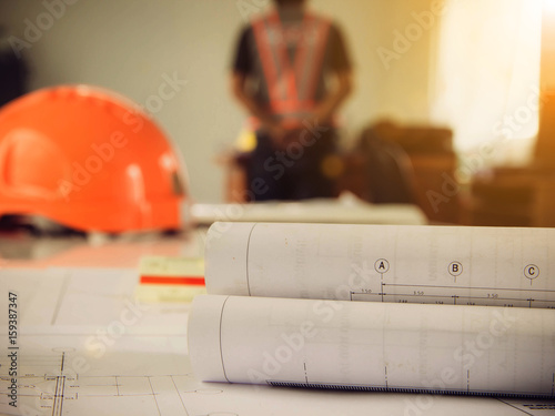 Silhouette construction industry blueprint of office building over silhouette construction industry blueprint of office building over blurred adult male engineer get job orders from malvernweather Image collections