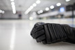 Black Hockey Glove on Ice