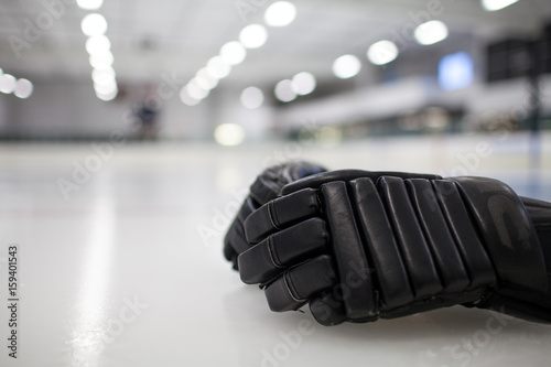 Black Hockey Glove on Ice Poster