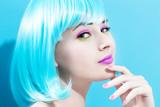 Fototapety Beautiful woman in a bright blue wig