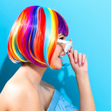 Fototapety Beautiful woman in a colorful wig