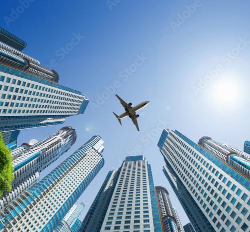 Plane encircled by buildings