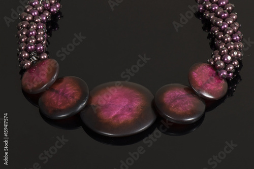 Beautiful elegant jewelry on a reflective black background - 159417574