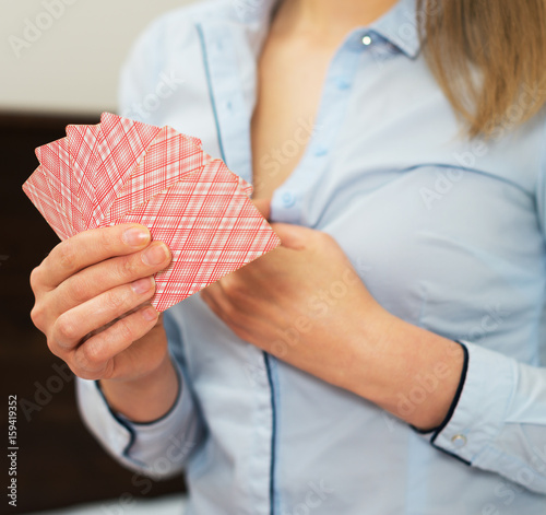 Woman playing in strip poker at home. плакат