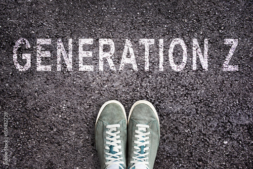 Text Generation Z written on asphalt with shoes, generation Z concept