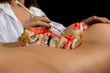 naked girls back like a table, with sushi. beautiful woman eating rolls using sticks. Unusual restaurant
