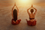 woman is practicing yoga at garden,Woman Yoga - relax in nature,Young woman doing yoga in morning park