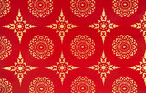 Ancient Traditional Thai Design Painting with Golden Stars and Flowers on Red Background - 159442588