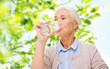 Quadro happy senior woman with glass of water at home