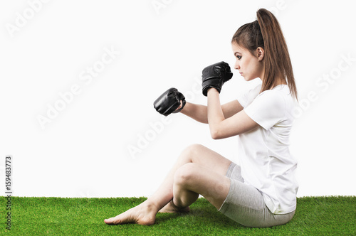 Póster Boxing girl on the green grass. White background