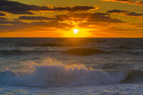 ocean sunset latge golden ball setting to ocean