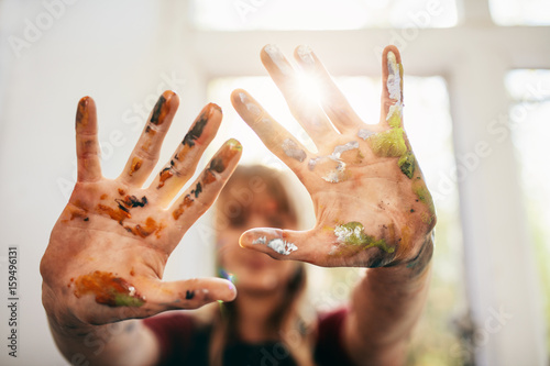 Messy hands of female painter
