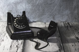 Vintage telephone on old wooden table. - 159506398