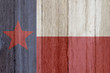 A rustic old Texas flag on weathered wood