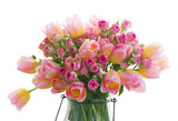 Bouquet of fresh pink and yellow tulips and roses flowers close up isolated on white background