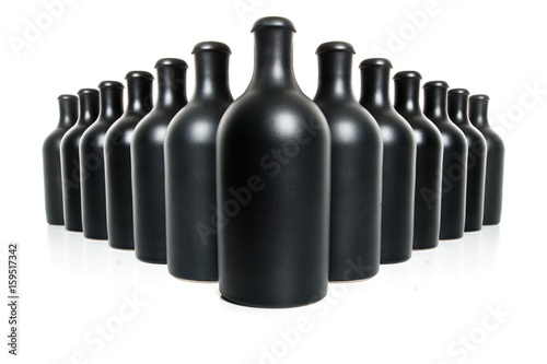 Poster Set of black clay bottles on a white background..