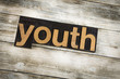 Youth Letterpress Word on Wooden Background