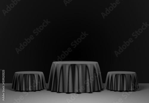 Three black round podium in the scene. 3d render
