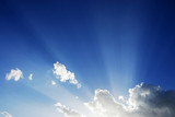 sunbeam radiating from behind the cloud - 159536752