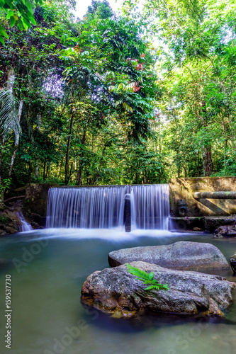 Cascades of waterfall over rock ledges © ZAIRIAZMAL