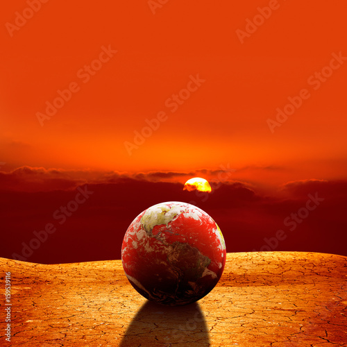 surreal global warming concept of globe on dried land