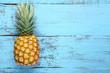 Quadro Ripe pineapple on blue wooden table